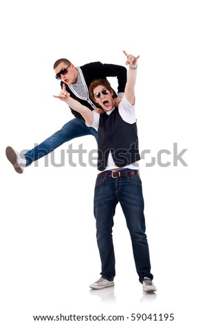 two young casual men isolated on white - party starters jumping around - stock photo