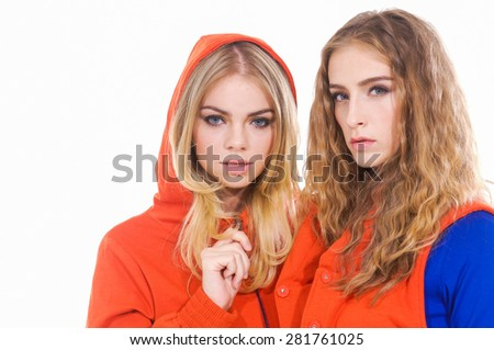 two young casual woman â??white background - stock photo