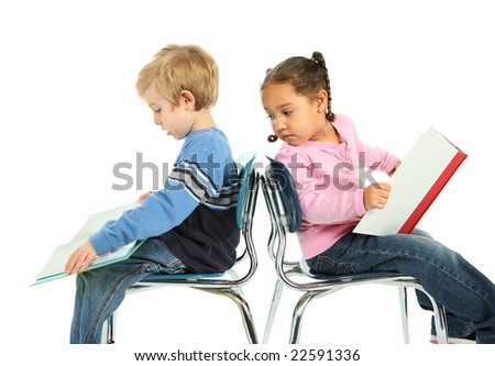 Two young children sitting and reading - stock photo