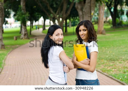 two young college students talking in school campus