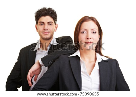 Two young content business people looking into the camera - stock photo