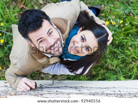 Two young couple looking up - stock photo