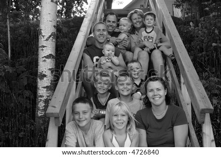 Two young couples with their kids - stock photo