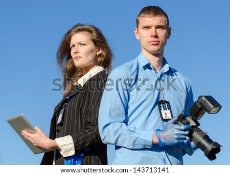 Two young criminalists on a sky background - stock photo