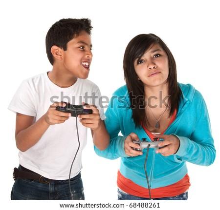 Two young cute Hispanic kids playing video games - stock photo