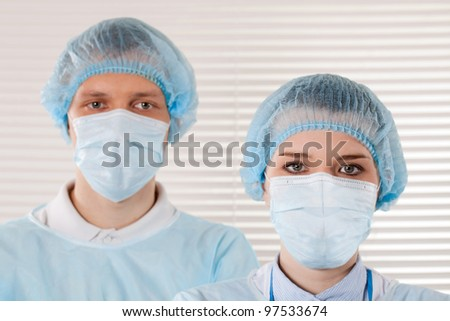 Two young doctor on a white background