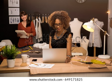 Two young entrepreneur women, and fashion designer working on her atelier
