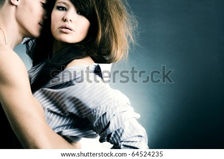 Two young fans in passionate embraces. - stock photo