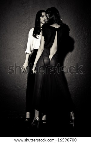 Two young female models, photographed in the studio. - stock photo