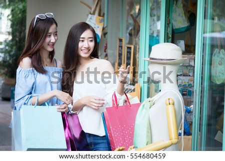 Two young friend women shopping in shopping mall. Business shopping situation idea concept.