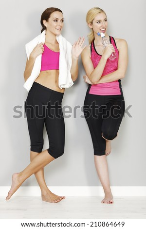 Two young friends resting after long workout at gym - stock photo