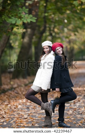 Two young friends standing and staring at camera - stock photo