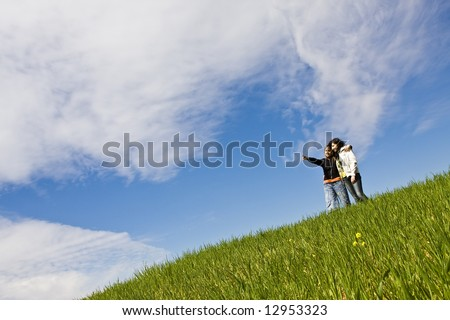 Two young friends up in the hill. - stock photo