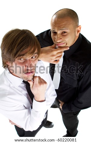 Two young funny businessmen over isolated white background acting goofey.