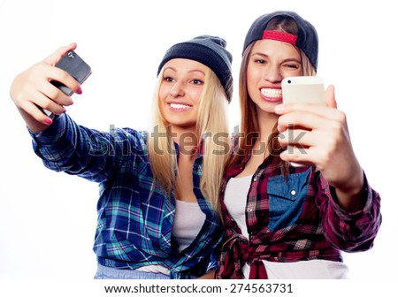 two young funny women taking selfie with mobile phone  - stock photo