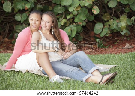 Two young gay women in the park - stock photo