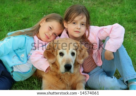 Two young girl and dog -  golden retriever - stock photo