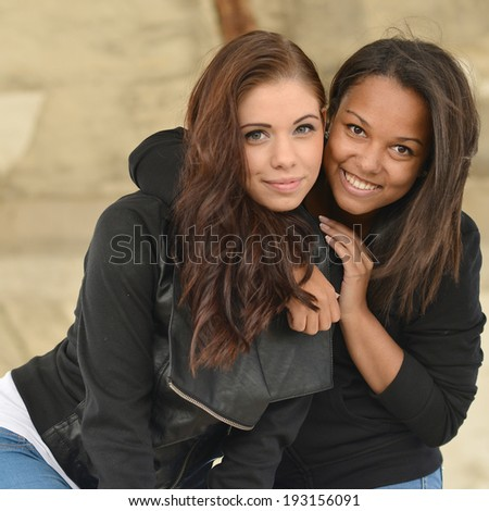 Two young girl friends together having fun - stock photo