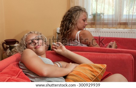Two young girl in sitting room. - stock photo