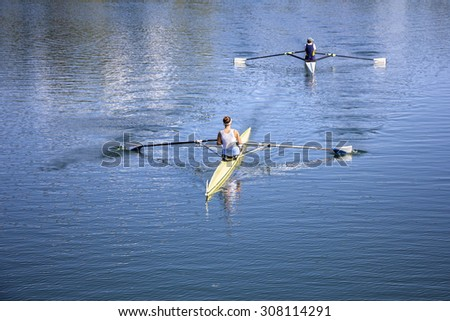 Two Young girl rowers training rowing on the Lake Jarun - stock photo
