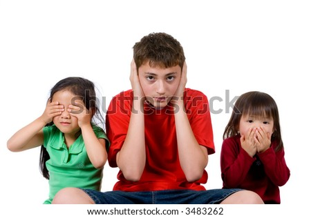 Two young girls and a teenage boy act out the proverb. see hear speak no evil. - stock photo