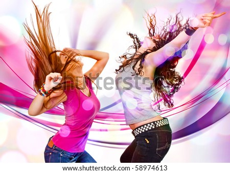 two young girls dancing in discolight - stock photo