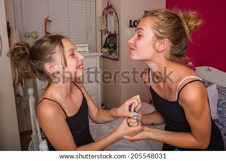 Two young girls fighting over a phone - stock photo