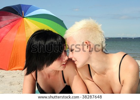 two young girls flirting on the beach
