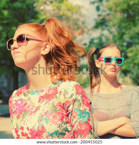 Two young girls girlfriend quarreled. Photo toned style instagram filters - stock photo