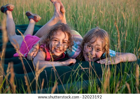 Two young girls having fun