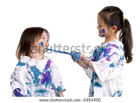 Two young girls having fun painting everything. Childhood, learning, exploration family - stock photo