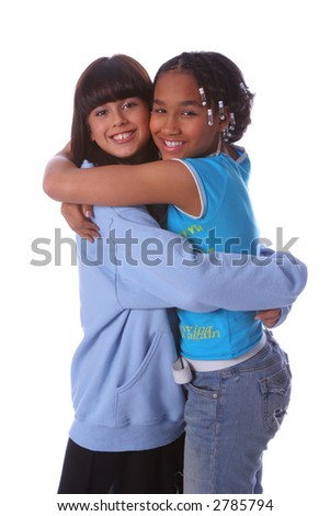 Two young girls hugging each other - stock photo