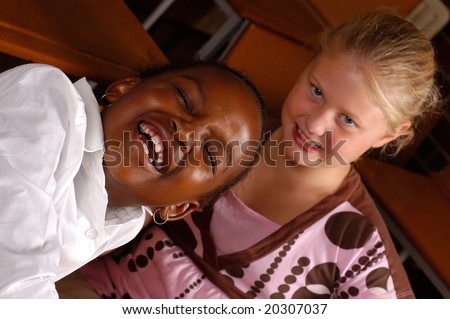 Two young girls messing about - stock photo