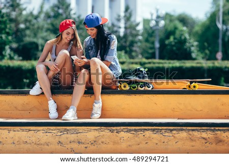 two young girls on the skate park