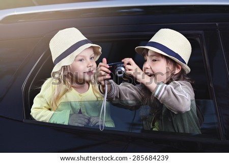 Two young girls on the trip with photo camera - stock photo
