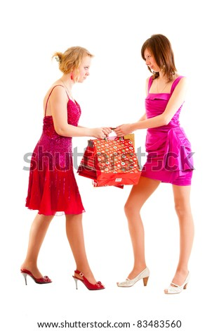 Two young girls quarrel for shopping purchases - stock photo