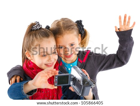 Two young girls taking a self portrait with a camera