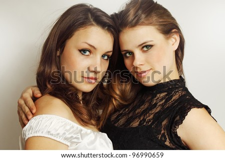 Two young girls tenderly embracing each other - stock photo