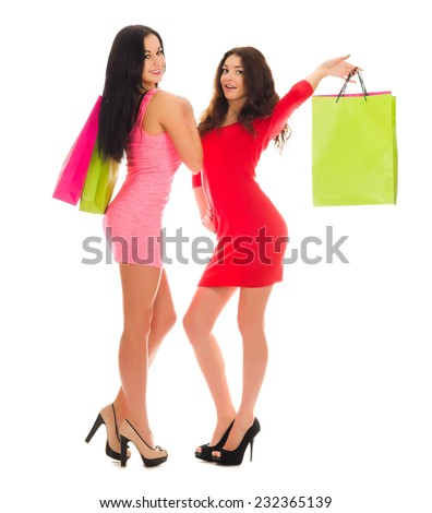 Two young girls with paper bags isolated - stock photo