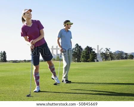 Two young golfers on course