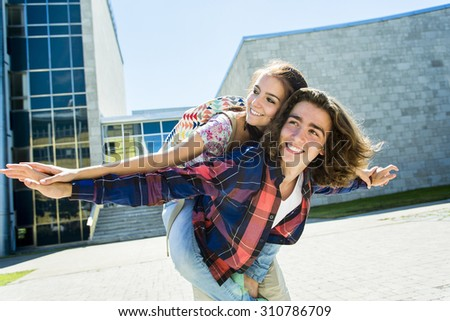 Two Young handsome friends student at the college, outdoors.  - stock photo