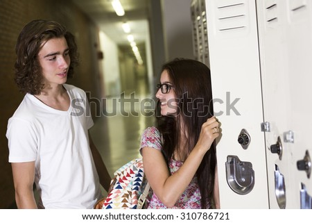 Two Young handsome woman and men student at the college locker - stock photo