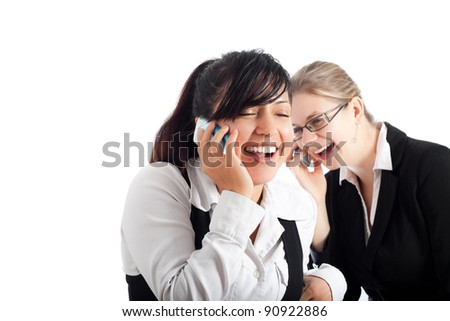 Two young happy business women on the phone, isolated on white background with copy space.