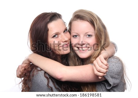 Two young happy girlfriends