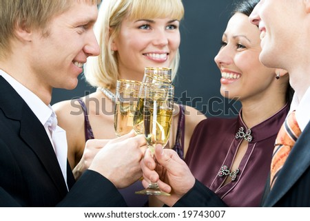 Two young happy smiling couples with champagne glasses