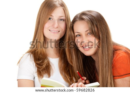 two young happy student girl, isolated on white - stock photo