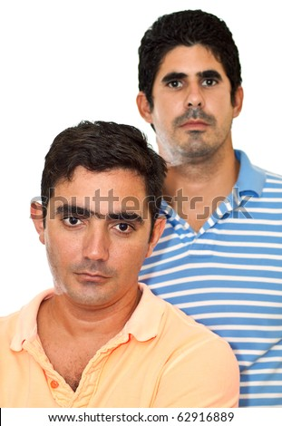 Two young latin men isolated on a white background - stock photo