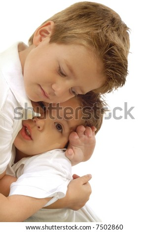 Two young little boys hugging each other; isolated on white - stock photo