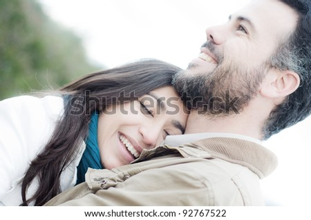 Two young lovers embraced - stock photo