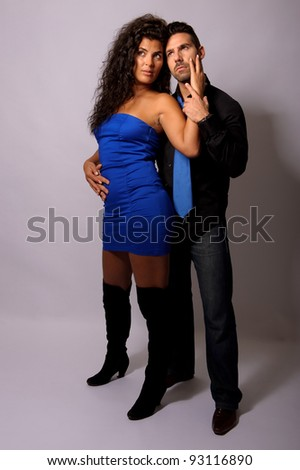two young lovers in a tender position studio portrait - stock photo